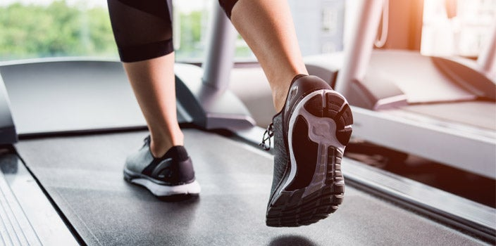 Why Exercise During Chemo is Beneficial - Woman's Tennis Shoes walking on treadmill