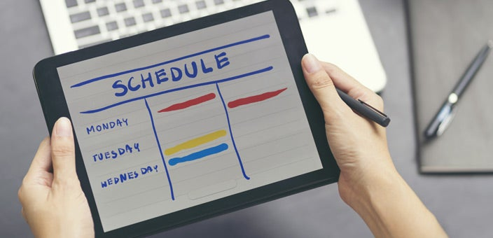 Woman holding tablet with schedule: Be prepared