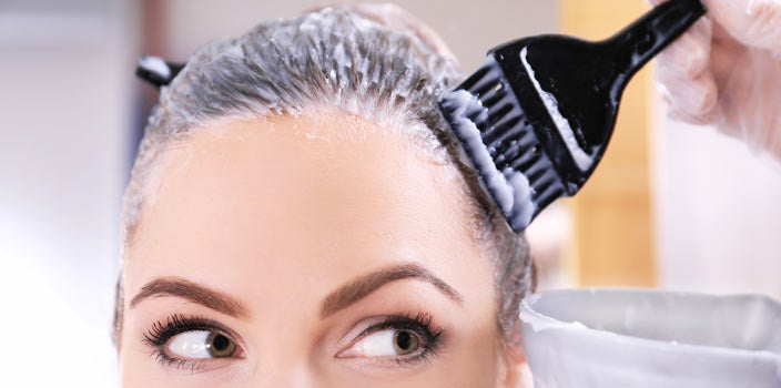 Hide Thinning Hair - woman getting hair dyed