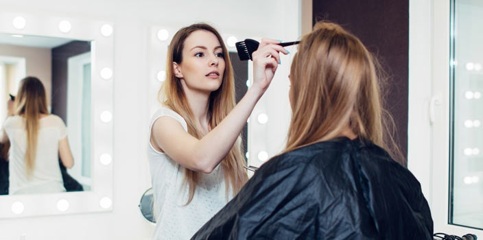 Thinning Hair - Stylist parting ladies hair