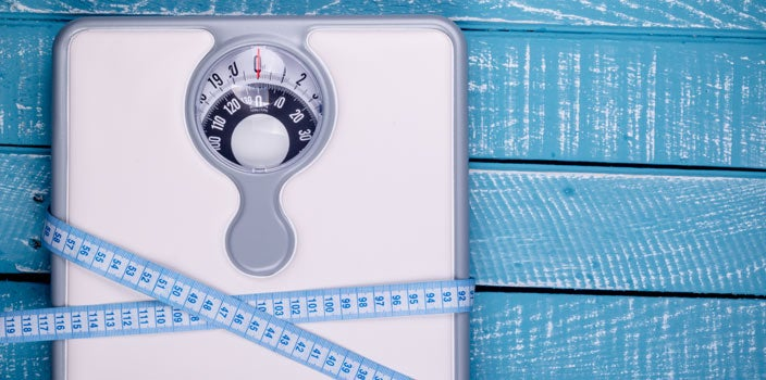 Unexpected cause of hairloss- dramatic weight loss - scale with measuring tape around it