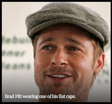 Brad Pitt wearing flat cap.