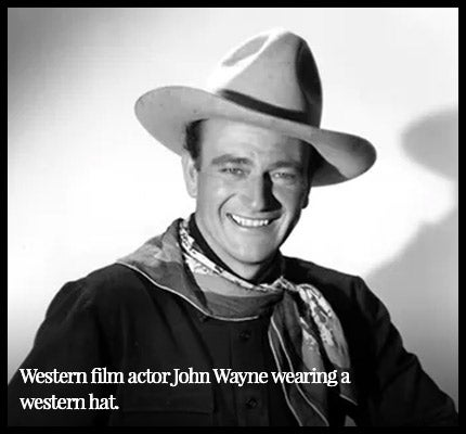 John Wayne wearing western hat.
