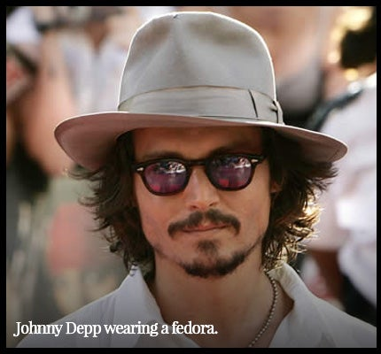 Johnny Depp wearing fedora.