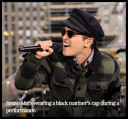 Bruno Mars wearing a mariner's cap.