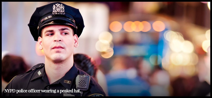 NYPD Police officer wearing peaked cap.