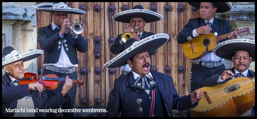Mariachi band wearing sombreros.