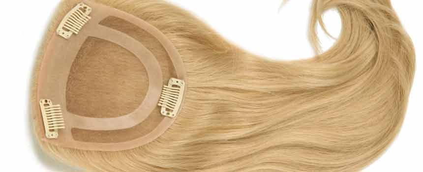 Hair toppers buying guide for example if your hair is thinning mainly at the part you may need a base that is long and skinny with a monofilament construction solutioingenieria Gallery