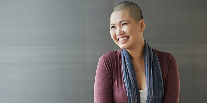 After Treatment - Woman smiling after cancer treatments