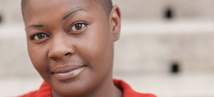 Alopecia Myths - African American woman with alopecia.
