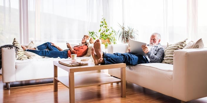 do things you love - couple relaxing listening to music and playing on iPad