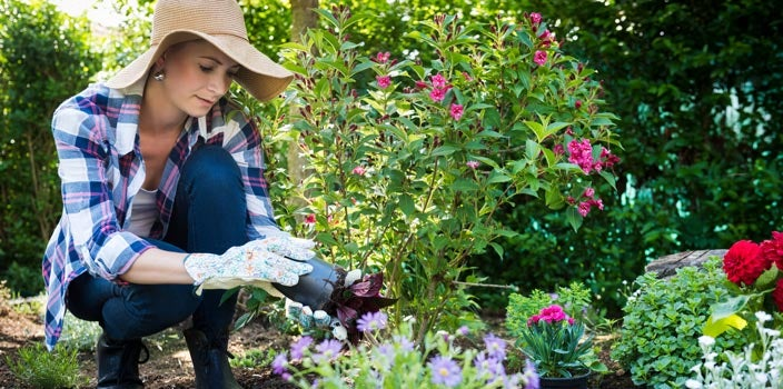 get out in the sun - woman gardening