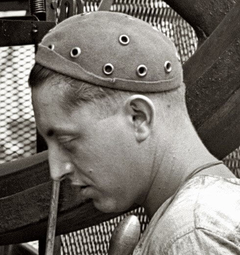 man wearing shorpie beanie, beginning of men wearing beanies