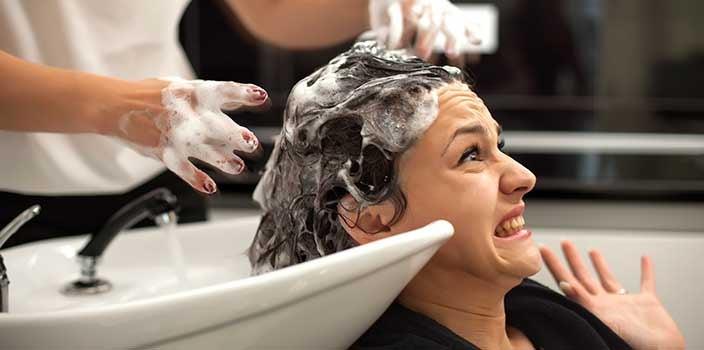 Woman getting hair shampoo'd