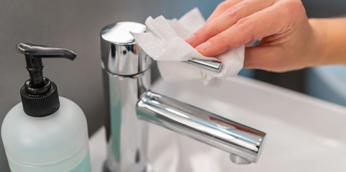 Wash hands right for coronavirus - Turn off faucet with paper towel